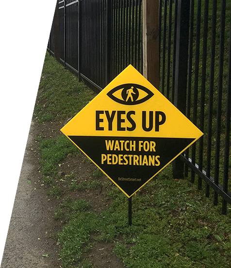 Eyes Up, Watch For Pedestrians Sign